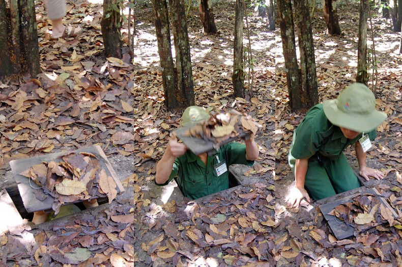 Here a tourist guide shows one of the trap doors on the jungle floor that leads down into the Cu Chi tunnels. Closed and camouflaged, they were almost undetectable.