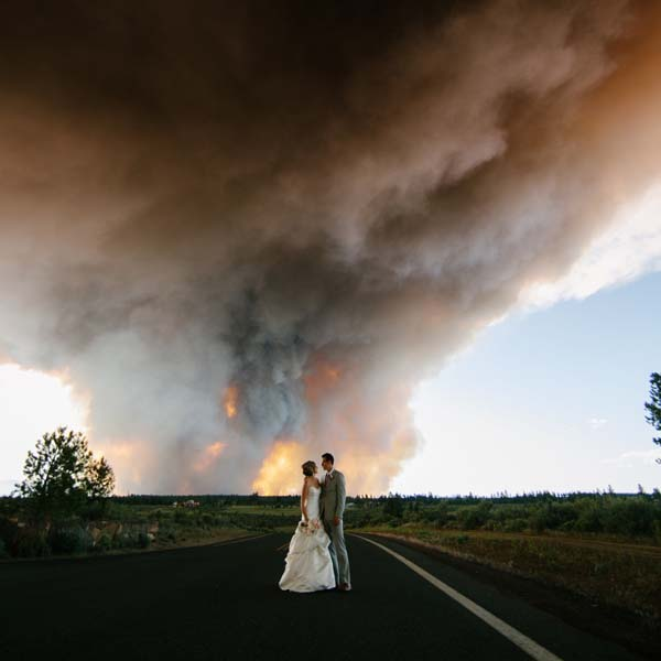 Josh Newton, their photographer, made sure to take pictures of both the ceremony and the fire in the background.