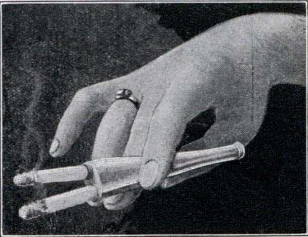 A mouthpiece that would let you smoke two cigarettes at once (1932).