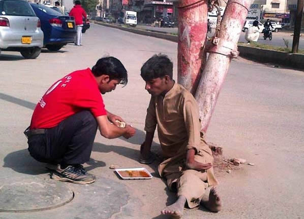 13. When this shop owner went outside to feed a disabled homeless man.