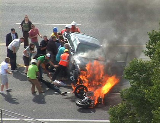 14. When these bystanders joined forces to literally lift a car off of a trapped motorcyclist.