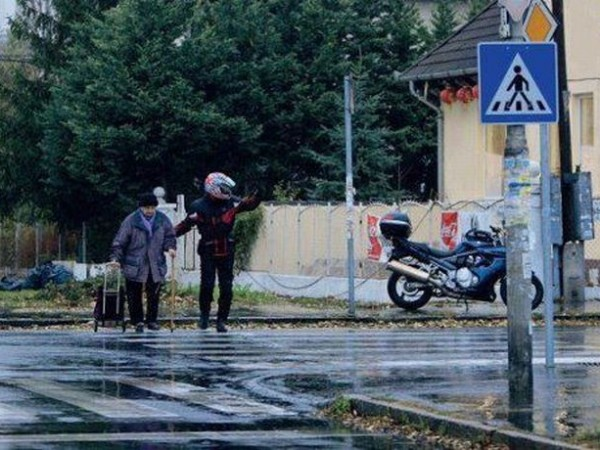 16. When this man got off of his motorcycle to halt traffic, so an elderly man could cross the street.